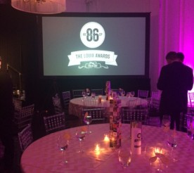 table and screen at the Louix awards