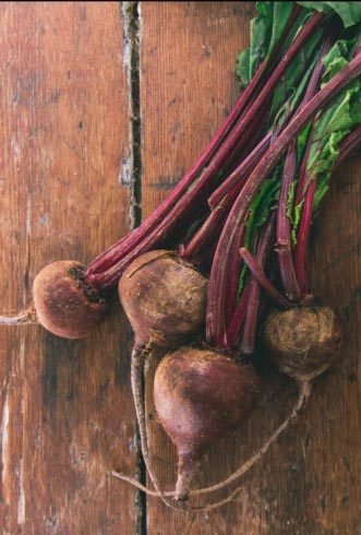 beets with stems on a wooden table