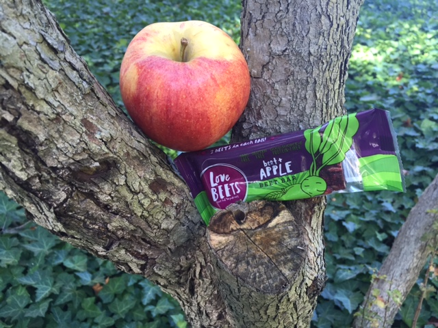 apple in a tree next to a beet and apple beet bar