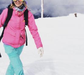 alpine athlete Katie Van Ripe on top of a snowy mountain