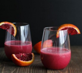 beet and blood orange smoothies garnished with oranges
