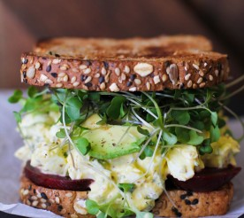 beet and egg salad sandwich with greens