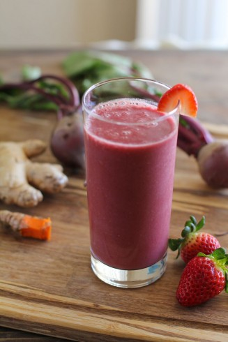 smoothie with beet juice and garnished with a strawberry